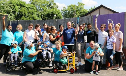 Vanquis team with CPotential staff and children