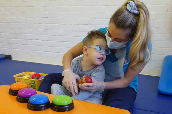 Boy in physiotherapy with therapist