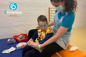Child in session with physiotherapist