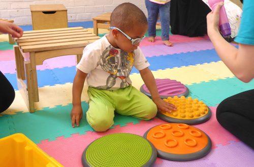 Boy touching sensory mats