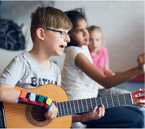 Image of a boy playing guitar