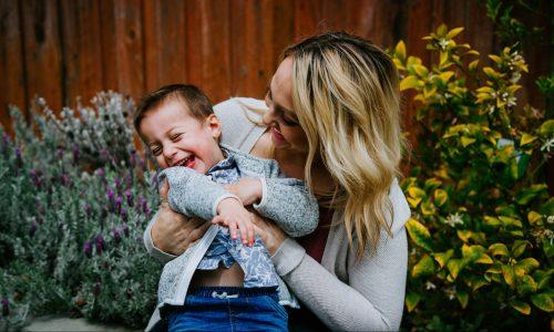 Parent cuddling child - courtesy of Gabe Pierce