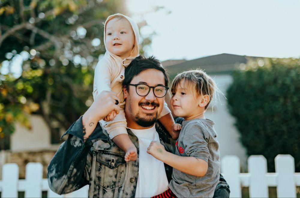 Dad carrying 2 children
