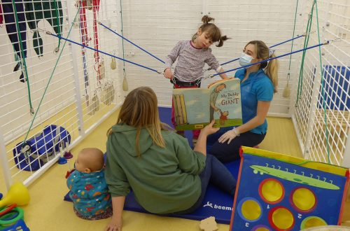 Girl with family in physiotherapy