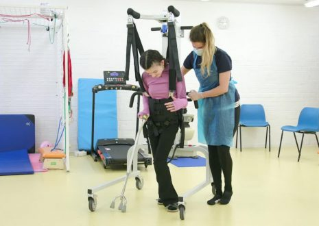 Physiotherapist with female client
