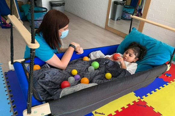 Child in Occupational Therapy ball pit