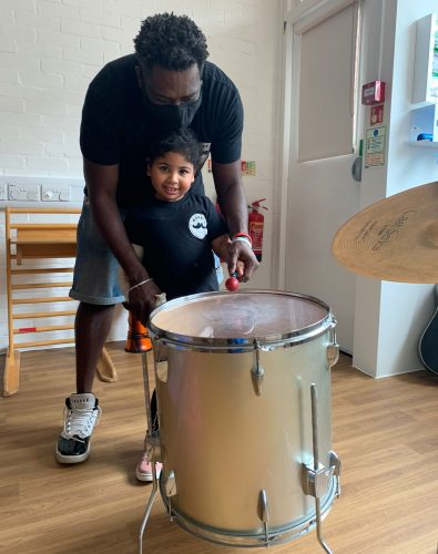 Dad with girl in Music Therapy and CIMT