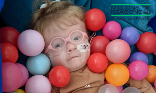 Child in OT session ball pool - Donate for cerebral palsy